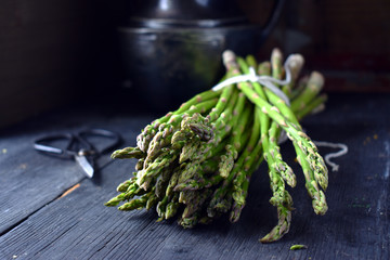 Fresh Asparagus bundle in rustic setting