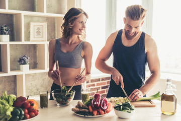 Zelfklevend Fotobehang Koken Couple cooking healthy food