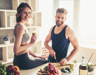 Couple cooking healthy food