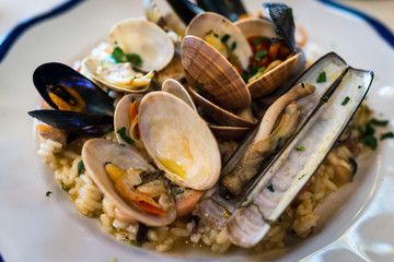 Italian delicious seafood risotto, rice with various of mussels in Positano, Italy