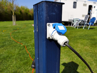 AC power sockets at a camping site, Full service campground electricity