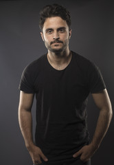 Caucasian guy wearing black T-shirt in studio