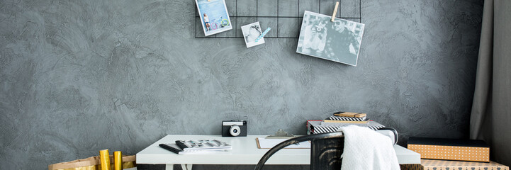 Desk and grey wall