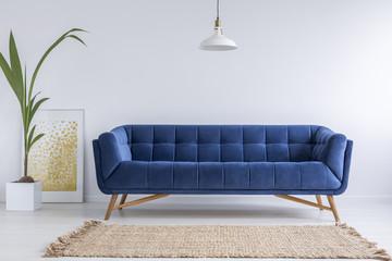 Blue sofa and wicker carpet