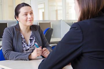 Smiling businesswoman on job interview. Boss women in business.