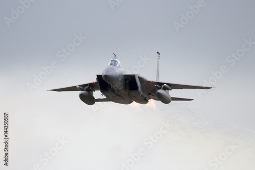 Military Fighter Jet Plane Low Flyby With Afterburner Stock Photo
