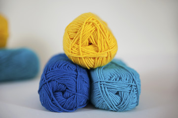 Lemon, turquoise and blue cotton yarn for knitting, needlework, or crochet projects. Lovely range of cotton in bright, strong colors for creative and relaxing hobbies.