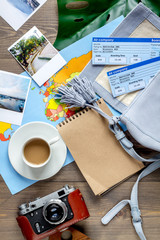 traveller set with coffee and tickets on wooden background top view
