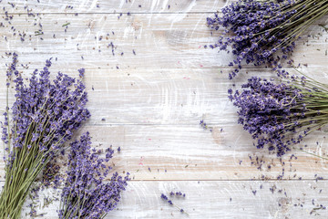 dry lavander design with bouquet on wooden background top view mockup