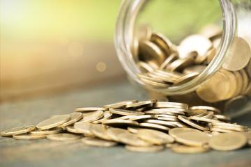 Golden coins closeup - money savings concept