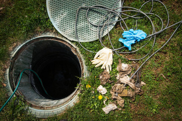 Unclogging septic system. Cleaning and unblocking drain full of disposable wipes and other non biodegradable items.