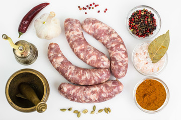 Raw homemade sausage with spices
