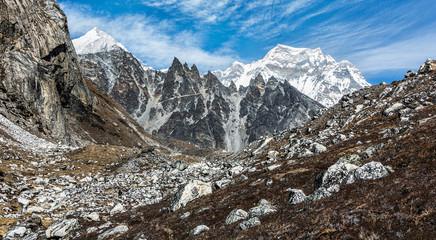 Alone tourist on the trek to the background of the Cho Oyu (8153 m) - Gokyo region, Nepal, Himalayas