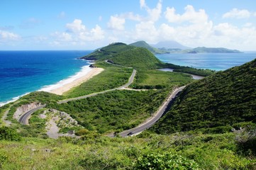 Scenic view from elevated overlook towards St. Kitts isthmus and Nevis Island, St. Kitts.