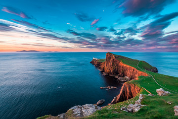 Famous dusk at the Neist point lighthouse in Scotland Wall mural