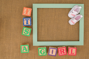 Its A Girl photo frame with baby shoes