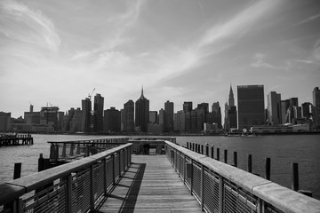 Pier and buildings of Manhattan in black and white style, New York