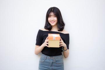 Portrait of thai vietnam teen beautiful girl hold gift box in hands
