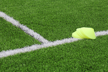 Chips on an artificial lawn with markings on a football field. Sports background.