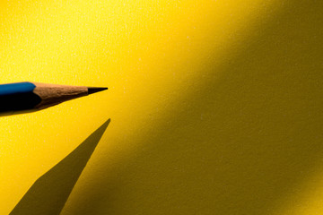 Pencil holding to write on the paper in shadow