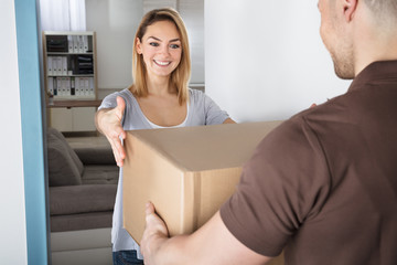 Surprised Woman Looking At Parcel