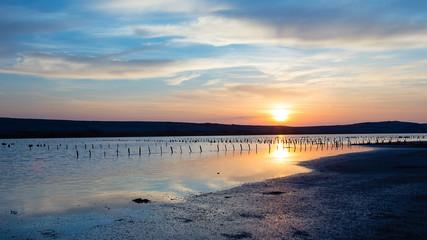 Antique Saline with beautiful sunrise - sea landscape - Salt production field