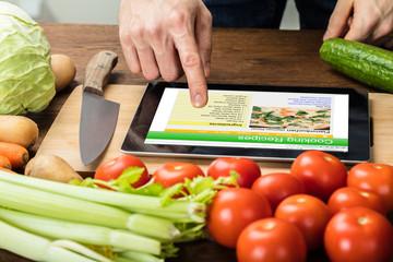 Person Is Preparing Recipe Using Digital Tablet