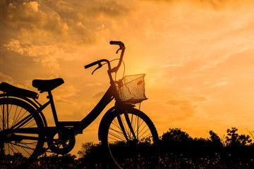 landscape image beautiful with Silhouette vintage Bicycle at sunset