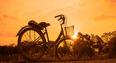 old bicycle style at summer grass field, beautiful landscape with sunset