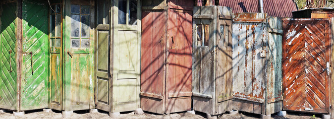 It is the line of aged vintage cracked wooden old doors
