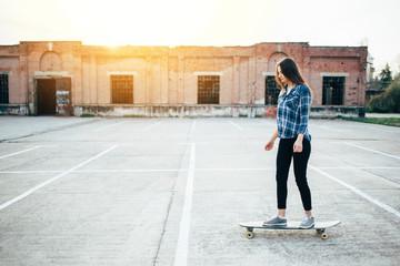 Hipster girl enjoy longboard riding