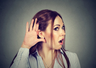 Shocked woman eavesdropping. Rumors and gossips concept.