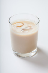 milk cocktail with a cherry in a tall glass
