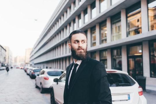 Portrait young handsome caucasian bearded businessman