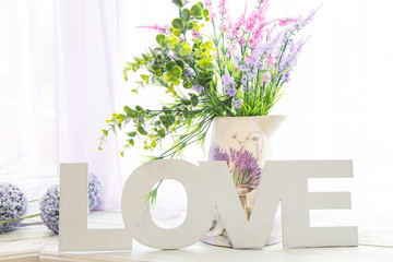 Provence background, with flowers and wooden letters love