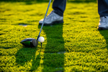 Man playing golf, partial view
