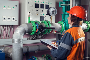 Female worker in pumping room