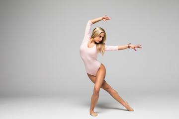 young woman ballerina ballet dancer dancing or gymnastics woman on white