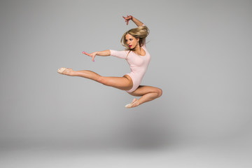 beautiful modern dancer posing and jump
