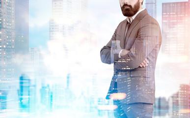 Bearded businessman in blue city