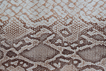 Genuine leather texture with imitation of exotic reptile with with an interesting pattern, trendy background, beautiful pattern. Concept of shopping, manufacturing