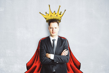 Businessman with crown and cape