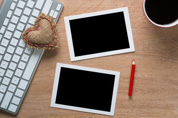 Blank photo frames on table
