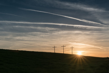 Crucifixes at dawn on Mersley Down, Isle of Wight, England