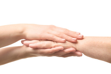 Old and young women holding hands on white background, closeup