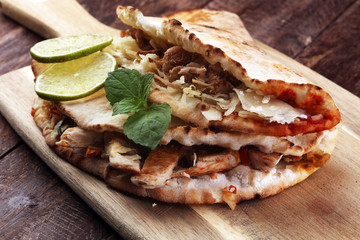 Delicious kebab sandwiches on wooden table