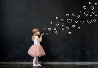 Cute Girl Sends an air kiss.