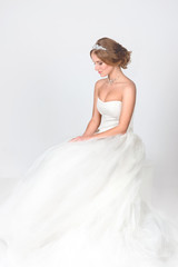 the bride  sits in a jewelry - a necklace from pearls and in a crown