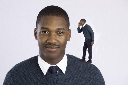 Happy black man talking to himself