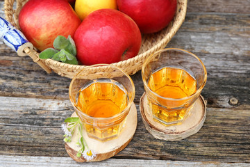 Apple juice and red apples